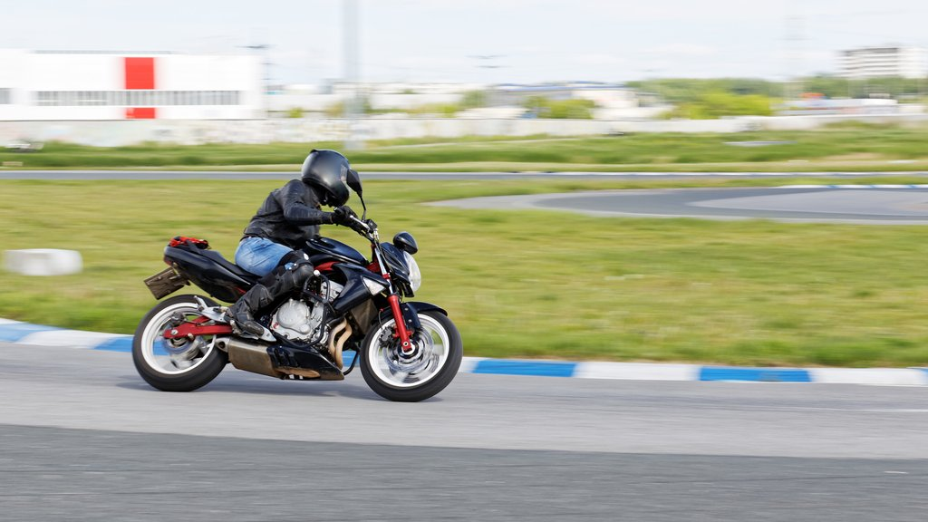A motorcycle racer makes a practice run on a sports track